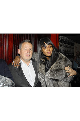 Interview's Editorial Director Fabian Baron and Naomi Campbell ( and Daks creeping thru the hallway behind them)