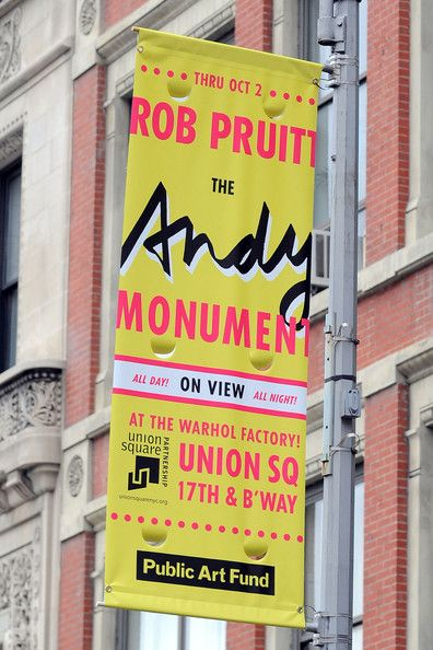 The Andy Monument by artist Rob Pruitt, a 7-foot shiny chrome homage to Pittsburgh native Andy Warhol, was unveiled Wednesday in front of the pop art king's former Factory studio in New York City's Union Square. The artist made the statue as he imagined Warhol in 1977: dressed in Levi's 501 jeans, a Brooks Brothers blazer, wearing a Polaroid camera around his neck and carrying a medium brown bag from Bloomingdale's.  This amazing monument was funded by New York's Public Art Fund.